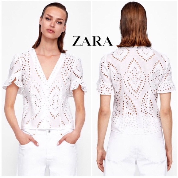 908634cc493e11 Zara die-cut embroidered white eyelet blouse- L.  M 5c5c6ca7194dad77af38d24a. Other Tops you may like. Off the shoulder shirt